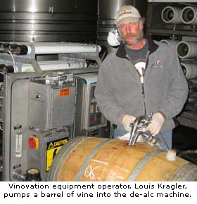 Vinovation equipment operator Louis Kragler pumps a barrel into the dealc machine.